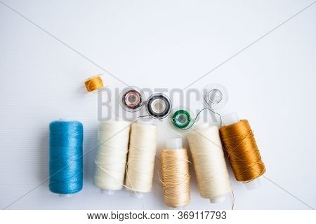 Sewing Tools On The White Background With The Copy Space
