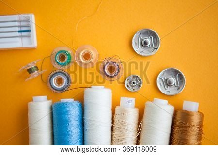 Sewing Tools On The Yellow Background With The Copy Space