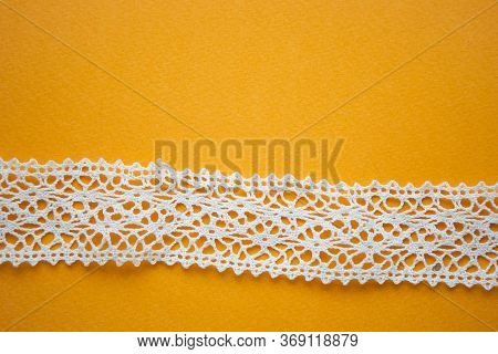 White Lace On Yellow Background With The Copy Space
