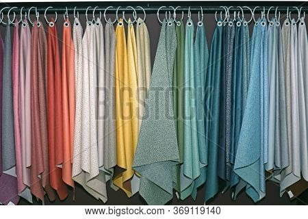 Textile Material Colorful Samples On Fashion Industry Factory Rack