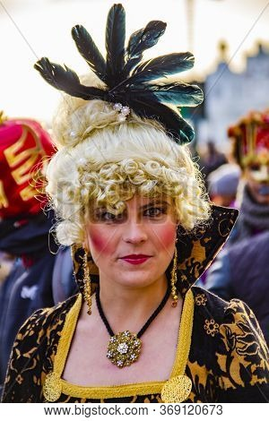 Venice, Italy - February 9, 2013: Unidentified Woman With Venetian Carnival Mask In Venice, Italy. A