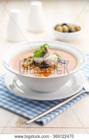 Fish Soup With Vegetables Lemon And Olives. Traditional Mediterranean Cuisine Soup. Serving In A Whi