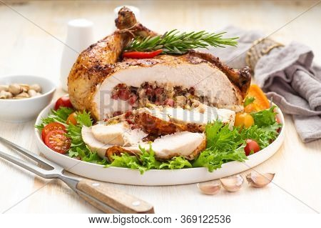Stuffed Boneless Chicken Garnished With Fresh Vegetables, Lettuce, Cherry Tomatoes, Bell Peppers And