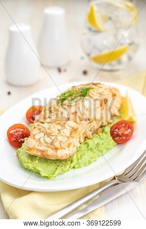 Salmon Fillet Fried In Almond Petals. Garnished With Cauliflower And Green Peas Puree. A Large Porti