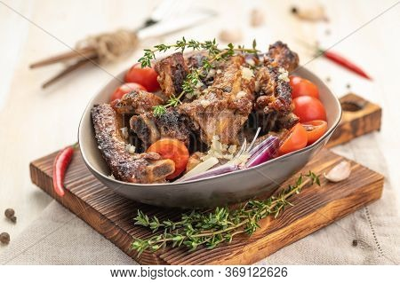 Grilled Pork Ribs In Spicy Sauce With Tomatoes. Ketogenic And Paleo Food. Large Portion On A White P