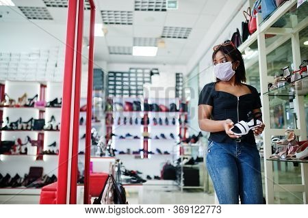 African American Woman Wearing Face Protective Medical Mask For Protection From Virus Disease In Sho