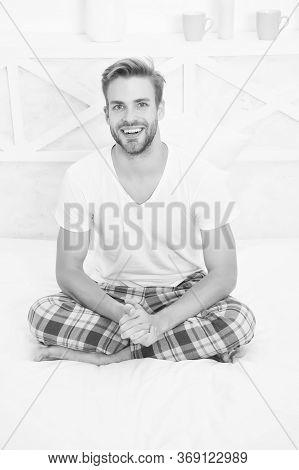 Healthy Sleep Concept. Tips Promoting Healthful Sleep Habits. Handsome Man Relaxing In Bed. Establis