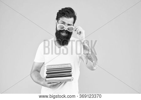 Colorful Stationery. Supplies For Arts And Drawing. Notepad Notebook. Hipster Eccentric Guy Hold Pil