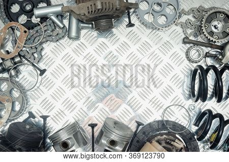 Old Car Spare Parts On Metal Workbench Flat Lay Background With Copy Space.