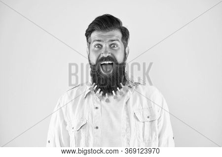 Confident And Handsome. Man Clothespin On Beard. Brutal Male Put Clothespin With Hearts On Beard. Be