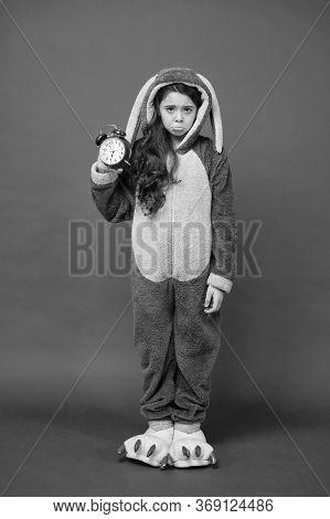 Regular Day Beginning. Adorable Bunny Hold Alarm Clock. Small Girl In Bunny Costume. Child Rabbit Ki