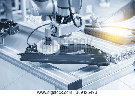 The Engineer Program Robotic Arm For Polishing  Automotive Parts. The Hi Technology Automotive Parts