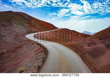 Road Through The Scenic Landscape To The Destination In Timanfaya Natural Park In Lanzarote,canary I