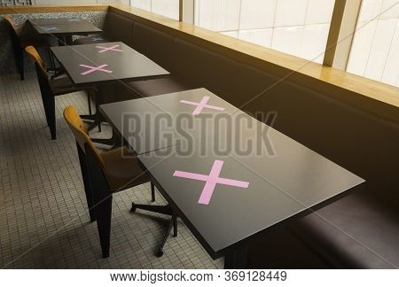 Row Of Table For Dining In A Food Court In Bangkok, Thailand. The Cross Is Marked In A Position Wher