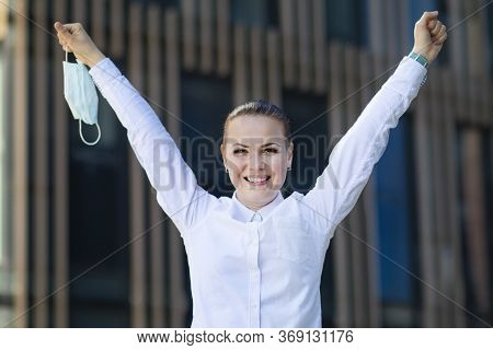 Happy Positive Girl, Young Beautiful Woman, Businesswoman Takes Off Protective Sterile Medical Mask