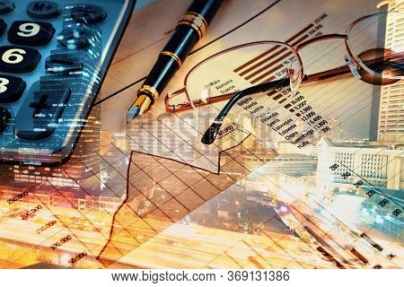 Finance And Business Concept.pen,calculator Over Graphs And Charts.double Exposure With City Lights.