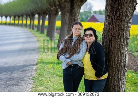 Youthfully Looking Asian Mother In Her 50s Enjoys Outing With Her 11 Years Old Daughetr