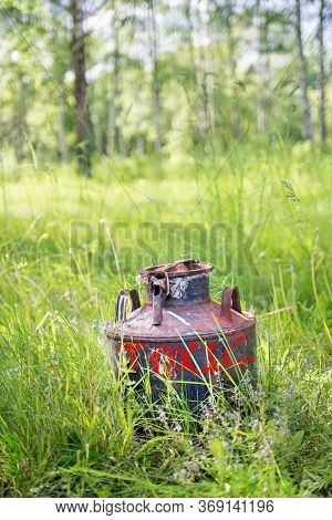 Old Rusty Metallic Can With Red Inscription Toxic On The Grass In The Nature Environment In Summer