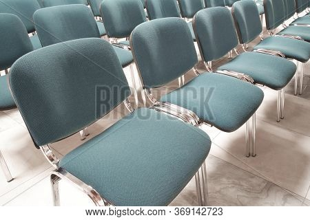 Conference Chairs In Business Room, Rows Of White Plastic Comfortable Seats In Empty Corporate Prese