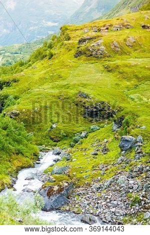 Stream River And Old Country Houses Cabins In The Mountains. Beautiful Landscape In Norway, Scandina