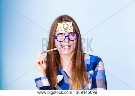 Woman Confused Thinking Seeks Solution, Paper Card With Light Idea Bulb On Her Head. Girl Is Trying