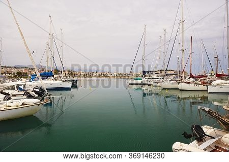 Rethymno, The Crete Island, Greece - May 30, 2019: Beautiful Big White Yachts In The Seaport Of The