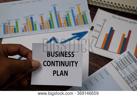 Business Continuity Plan Write On Sticky Note Isolated On Wooden Table.