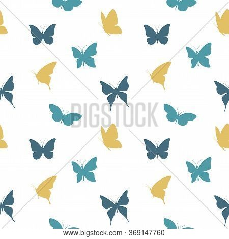 Butterflies Flying In Blue And Yellow Colors Seamless Pattern. Butterfly Design For Fabric, Paper.