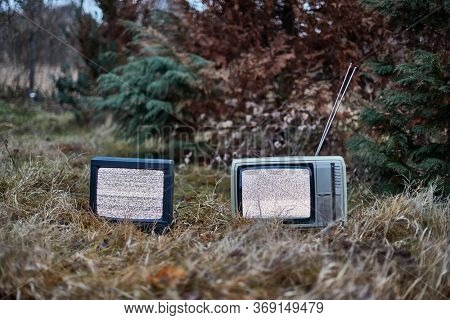 White noise on two analogue TV sets in outdoor environment