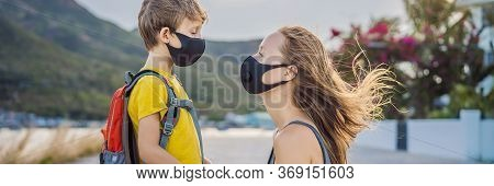 Mother Puts Her Child A Face Protective Mask On The Street. Stop The Infection. Coronavirus Quaranti