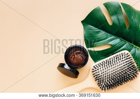 Hair Care Concept. Wooden Hair Brush And Natural Hair Mask Lie On Beige Background. Spa Hair Care. F