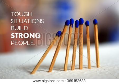Inspirational Quote - Tough Situations Build Strong People. On Background Of  Blue Wooden Matches St