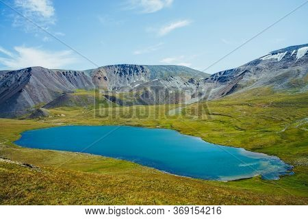 Aerial View To Beautiful Alpine Lake And Mountains With Snow In Sunlight. Awesome Landscape With Viv