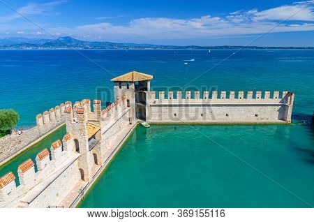 Small Fortified Harbor With Turquoise Water, Scaligero Castle Castello Di Sirmione Fortress, Sirmion