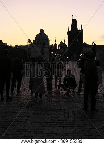 Prague, Czech Republic, October 13, 2019. A Group Of Photographers Shoots The Dawn On The Charles Br