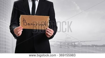 Bankruptcy Message On Cardboard In The Hands Of An Airline Representative. Airline Bankrupt