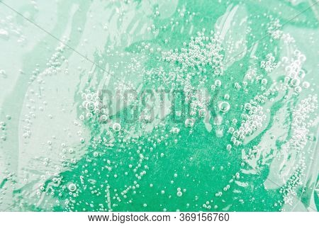 Texture Background With Hyaluronic Acid Bubbles. Cosmetics And Skin Care. Hemp Oil.