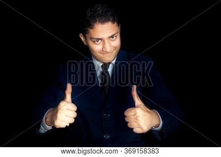 Portrait Shot Of Smiling Charming Young Businessman In Dark Blue Shirt And Wishing Best Wishing Good