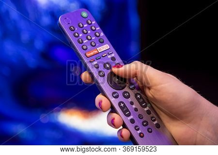 Moscow, Russia - October 04, 2019: Female Hand Holds Smart Tv Remote Control With Netflix Button Wit