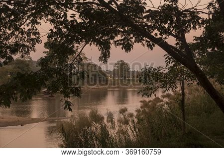 The Landscae And Sunset At The Mae Nam Kok River In The City Of Chiang Rai In North Thailand.   Thai