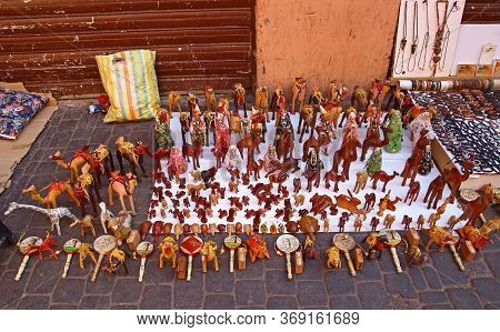 Marrakesh, Morocco - 12 October, 2019: Various Wooden Figures Of Camels And Other Souvenirs For Sale
