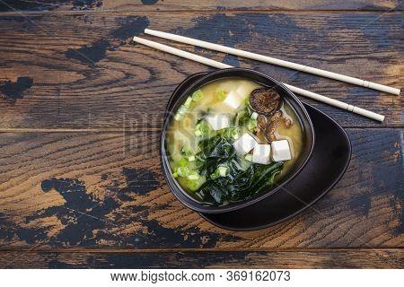 Japanese Traditonal Miso Soup With Wakame Seaweeds, Tofu And Shiitake Mushrooms On Bamboo Mat. Copy