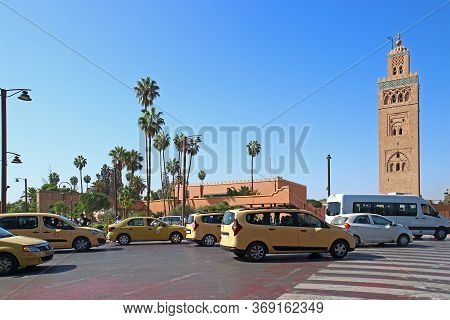Marrakesh, Morocco - 12 October, 2019: Street Traffic With Beige Cabs In Marrakesh. Typical Taxi Run
