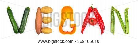 The Lettering Vegan Arranged With Different Colorful Vegetables On White: Zucchini, Potatoes, Butter