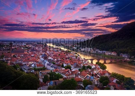Romantic Aerial View Of Heidelberg With Neckar River, Germany, A Dramatic Afterglow With Vibrant Red