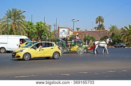 Marrakesh, Morocco - 12 October, 2019: Colorful Urban Transport In Morocco. Traditional Beige Taxis