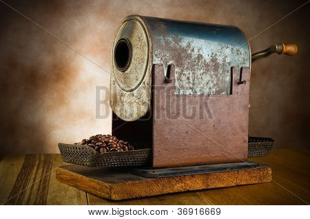 vintage roaster with coffee beans
