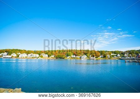 Fall Colors And New England Homes Across Harbor Of Boothbay Town And Harbor, Maine Usa.