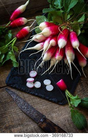 Summer Harvested Red Radish. Organic Vegetables. Raw Fresh Juicy Garden Radish On A Rustic Wooden Ta