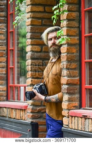 Looking For Someone. Brutal Man Traveler With Retro Camera. Photography In Modern Life. Travel Tips.